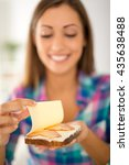 Small photo of Close-up of a female hands makin fresh sandwich. Selective focus. Focus on foreground, on sandwich.