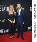 "Small photo of LOS ANGELES, CA - MARCH 21, 2016: Actor Aaron Paul & wife Lauren Parsekian at the premiere for the Hulu original TV series ""The Path"" at the Arclight Theatre, Hollywood."