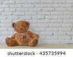 Cute Teddy Bear Sitting On...