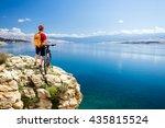 mountain biking rider with bike ... | Shutterstock . vector #435815524