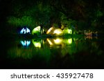 illuminated tent on a lake with ... | Shutterstock . vector #435927478