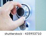 unlock safe box by hand rotate | Shutterstock . vector #435953710