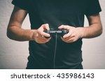 man playing on the joystick in... | Shutterstock . vector #435986143