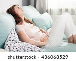 young woman in pain lying on... | Shutterstock . vector #436068529