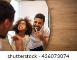 African American Girl Brushing...