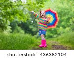 Little Girl Playing In Rainy...