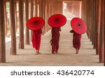 Three Buddhist Novice Hold Re...