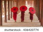 Three Buddhist Novice Hold Re...