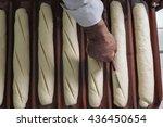 baker kneading dough in a... | Shutterstock . vector #436450654