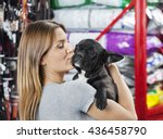 Stock photo woman kissing french bulldog at store 436458790
