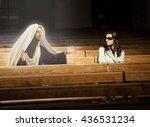 Woman Praying In Church And...