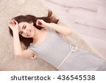 beautiful girl lying on floor | Shutterstock . vector #436545538