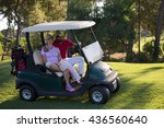 couple in buggy cart on golf... | Shutterstock . vector #436560640