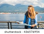 beautiful girl looking at the... | Shutterstock . vector #436576954