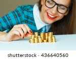 Saving  Woman Stacking Gold...