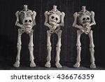 Headless Skeletons Holding...
