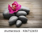 stones and red orchid on wooden ...   Shutterstock . vector #436712653