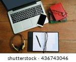 headphone and laptop on wooden  ...   Shutterstock . vector #436743046