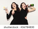 two beautiful women in black... | Shutterstock . vector #436784830