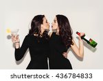 two beautiful women in black... | Shutterstock . vector #436784833