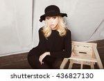 beautiful young woman sitting... | Shutterstock . vector #436827130