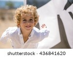happy boy playing on the beach...   Shutterstock . vector #436841620