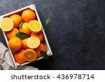 fresh orange fruits in wooden... | Shutterstock . vector #436978714