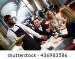 black waiter serving terrace... | Shutterstock . vector #436983586
