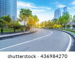Small photo of clean road with modern buildings background