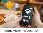 man is using free wifi in... | Shutterstock . vector #437053054