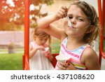 Cute Little Girl Eating Ice...