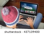 man playing poker online with...   Shutterstock . vector #437139400
