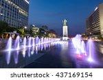 Small photo of Seoul, South Korea - Jun 14, 2106: Statue of Admiral Yi Sun-Sin and colour floor water fountain at night, Gwanghwamun plaza.