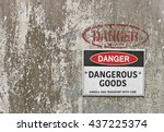 Small photo of red, black and white Danger, Dangerous Goods warning sign