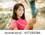 asian woman use of mobile phone | Shutterstock . vector #437285386