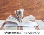 hardcover on vintage wood... | Shutterstock . vector #437289970