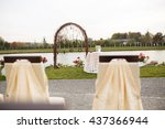 Stock photo creative cute decorated wedding arch and all exterior of holidays on the background autumn lake 437366944