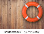 Life Buoy Hanging On Wooden...