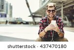 man sitting listening music... | Shutterstock . vector #437470180