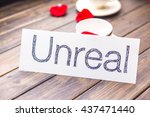 white paper with word unreal... | Shutterstock . vector #437471440
