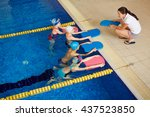 swimmers with coach | Shutterstock . vector #437523850