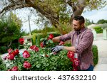 handsome young man gardener... | Shutterstock . vector #437632210