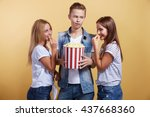 three young people with popcorn | Shutterstock . vector #437668360