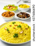 Small photo of Yellow rice and curry or kaha bath Sri Lankan food in white background