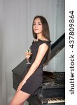 girl in a cocktail dress near... | Shutterstock . vector #437809864