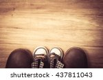 daddy's boots and baby's... | Shutterstock . vector #437811043