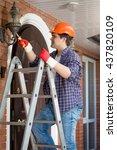 male electrician in hardhat... | Shutterstock . vector #437820109