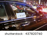 Small photo of New York, US - August 23, 2015. Uber car service on the streets of New York at Night. With selective focus on Uber logo.
