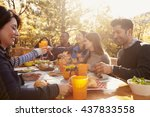 Group Of Happy Friends Eat And...