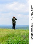 the adult man in a camouflage...   Shutterstock . vector #437875594